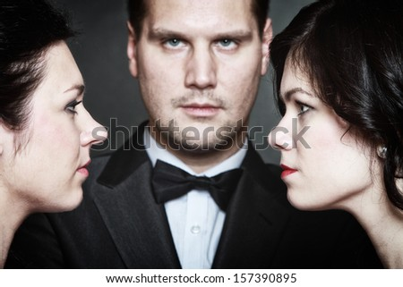 Relations between men and women - triangle. Passion of love hate. Infatuation love. Mistress betrayal within the family. Choice before wedding. Black background - stock photo