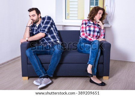 relationship and conflict concept - unhappy couple after quarrel at home - stock photo