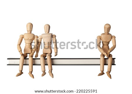 Relationship between three people depicted by three figurines isolated on white background  - stock photo