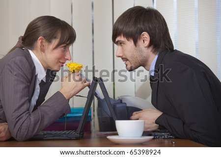 relationship by the work - happy man giving flower to woman - stock photo