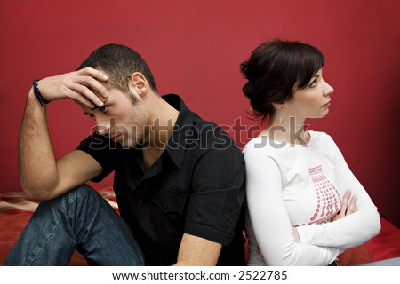 relationship difficulties: young couple having a fight - stock photo