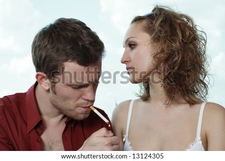 relationship difficulties: young couple having a problems - stock photo
