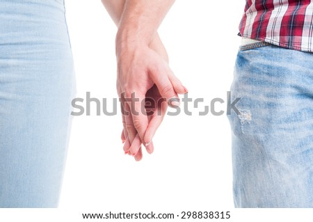 Relationship or couple togetherness concept with man and woman holding hands on white copy space or text area - stock photo