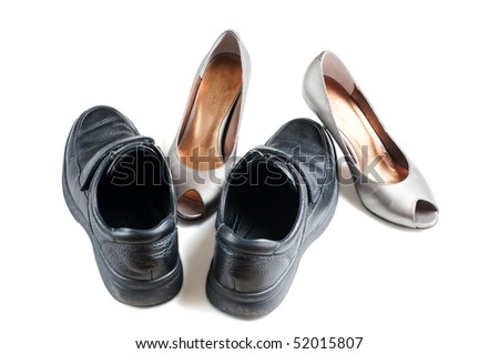 Relative place of men and women style shoes, seem to be two people hugging - stock photo