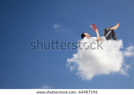 Relax and reading book on the cloud - stock photo