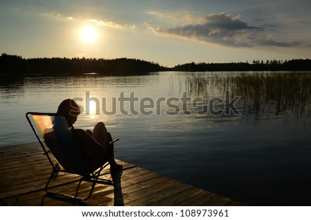 Relax at the sunset - stock photo