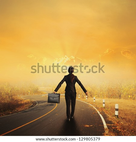 Relax business woman holding bag on Country road and sunset