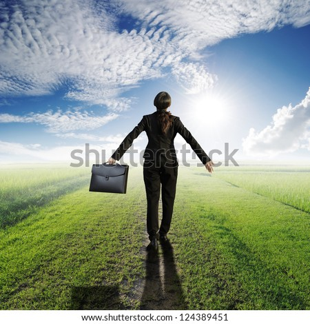 Relax business woman holding bag on Way of Grass Grass fields and sun sky