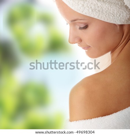 Relax concept:  beautiful nude woman with soft skin in bathtrobe - stock photo