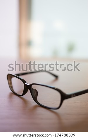 Relax eyes glasses on wood table, with beautiful depth of field