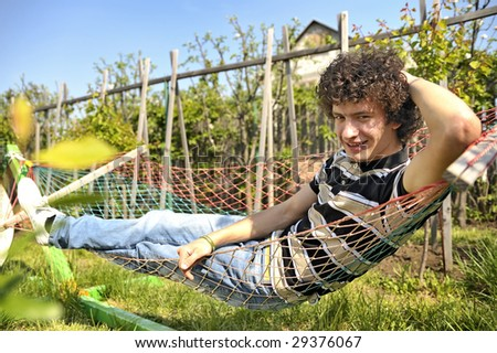 relax in a hammock - stock photo