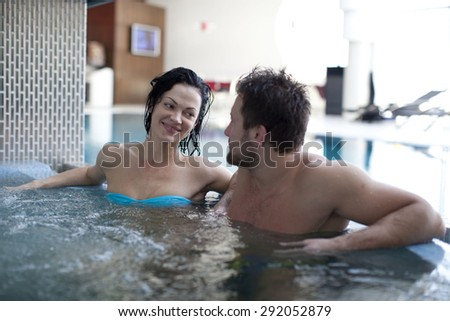Relax in jacuzzi of spa . focus on girl's face - stock photo