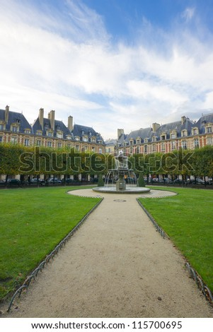 Relax in the park. Place des Vosges in the center of Paris. Very romantic square, typically French. - stock photo