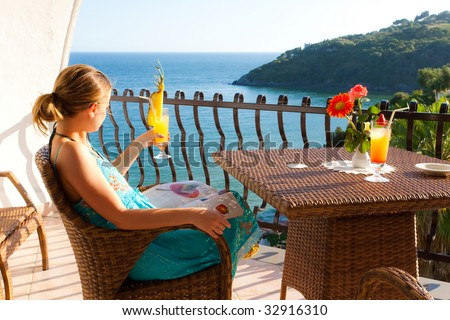 Relax moment with a fresh cocktail on a beautiful terrace overlooking the sea