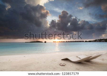 relax on beach at sunset - stock photo