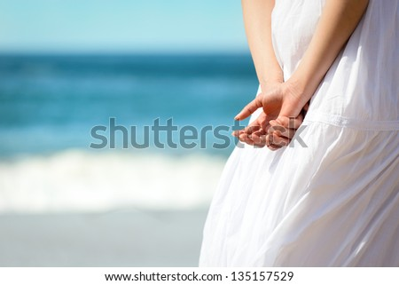 Relax on summer holidays concept. Woman on beach vacation relaxing. Copy space blue sea background. - stock photo