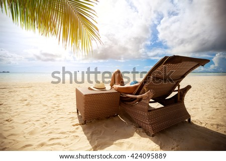 Relax on sunbeds on peaceful beach, holiday and vacation  - stock photo