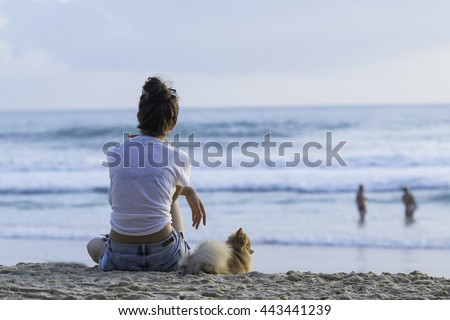 Relax on the beach with dog
