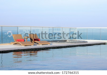 Relax Sun-beds near a swimming pool - stock photo