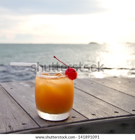 Relax with a mocktail by the beach  - stock photo