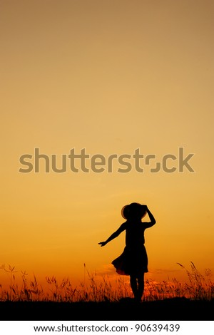 Relax woman and sunset silhouette