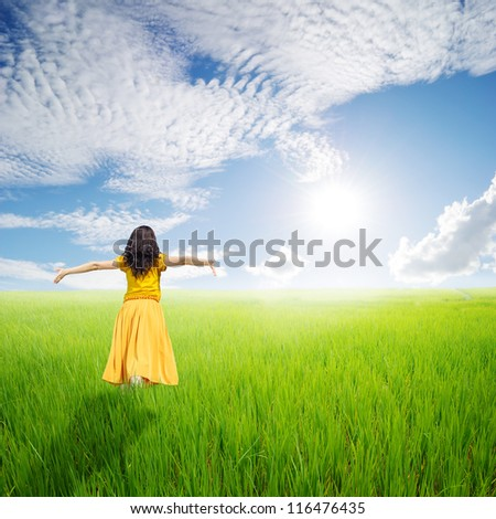 Relax Woman in green rice fields with blue sky