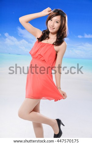 Relax young woman standing on the beach and blue sky - stock photo