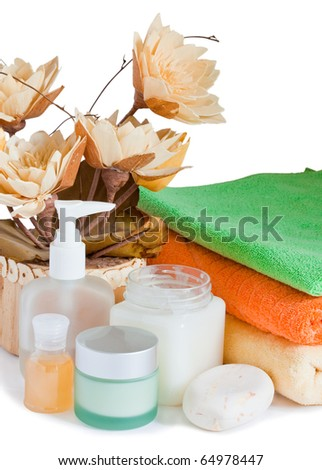 Relaxation and body treatment, towels and artificial lotus isolated on white background