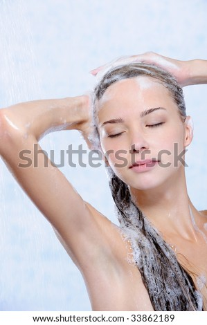relaxation of young woman taking shower - close-up portrait - stock photo