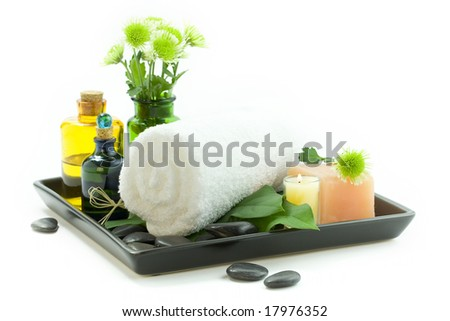 relaxation spa set with candles, essential oils, towel, pebbles and fresh flowers, suited for spa and healthy lifestyle usage - stock photo