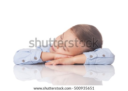 Relaxed and positive boy having day dream on isolated white
