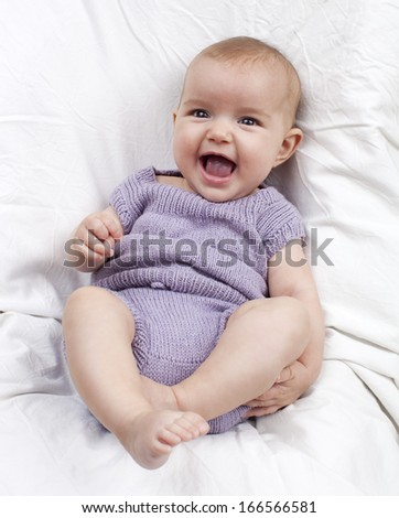 relaxed baby smiling - stock photo