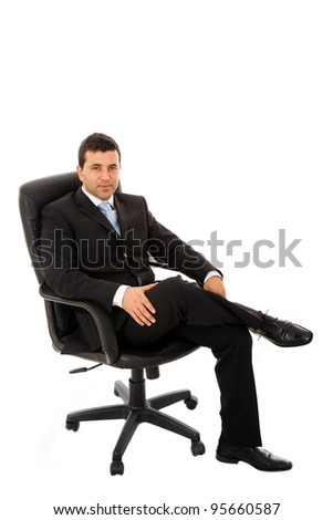 relaxed business man sits on office chair over white background - stock photo