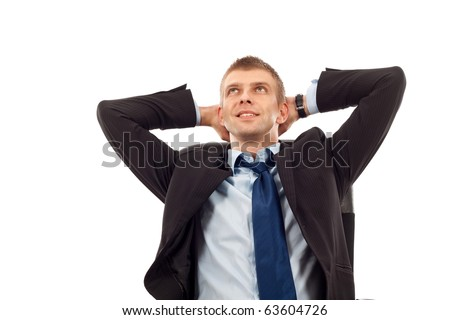 Relaxed business man sitting in his office chair, leaning back slightly with both palms supporting head,isolated. - stock photo
