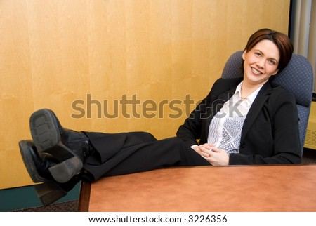 relaxed business woman with her feet up