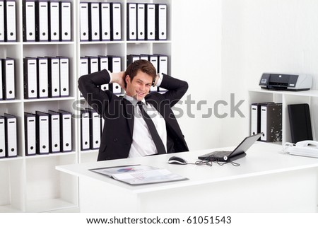 relaxed businessman in office - stock photo