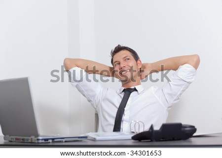 Relaxed cheerful smiling businessman enjoying success career - stock photo