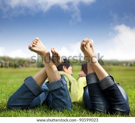 relaxed couple lying on the grass