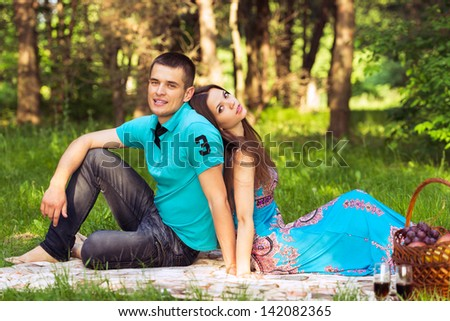 relaxed family at picnic in park. outdoors portrait couple - stock photo