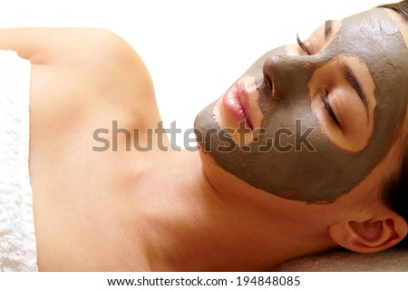 Relaxed girl having pore cleaning procedure in parlor