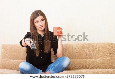 Relaxed girl watching TV - stock photo