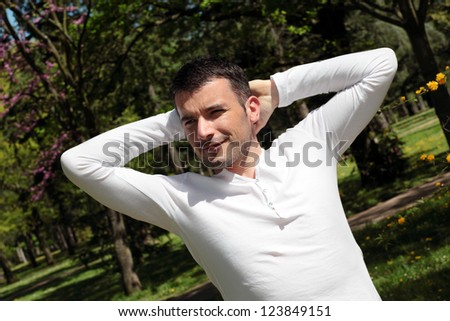 relaxed handsome man in a park - stock photo