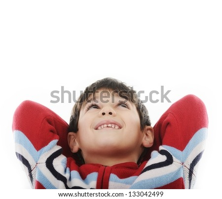 Relaxed happy child enjoying and looking up at copy space - stock photo