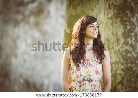 Relaxed happy woman enjoying leisure in park on spring. Old retro film look processing. - stock photo