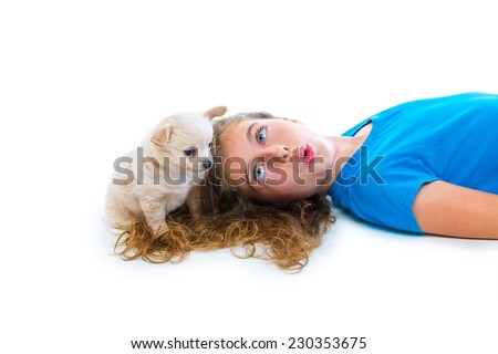 relaxed kid girl whistling puppy chihuahua dog lying happy on white background - stock photo