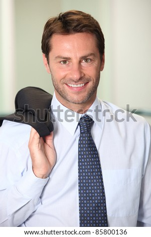 Relaxed male executive - stock photo