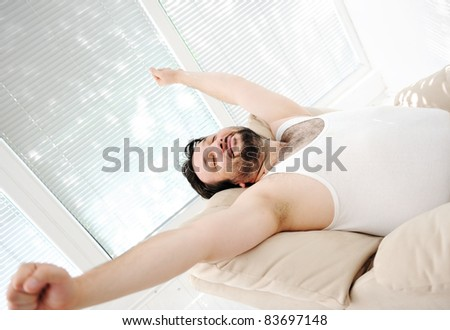 Relaxed man at home - stock photo