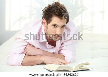 Relaxed man in front of a book