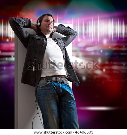relaxed man listening to good music - stock photo