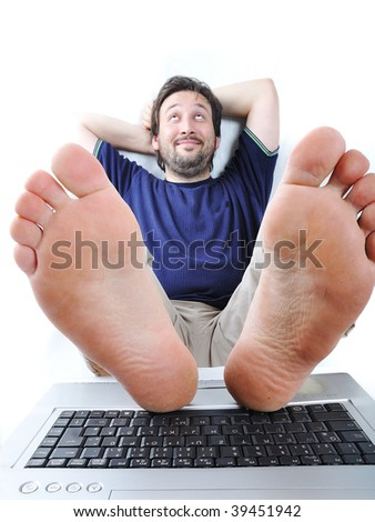 Relaxed man on laptop - stock photo